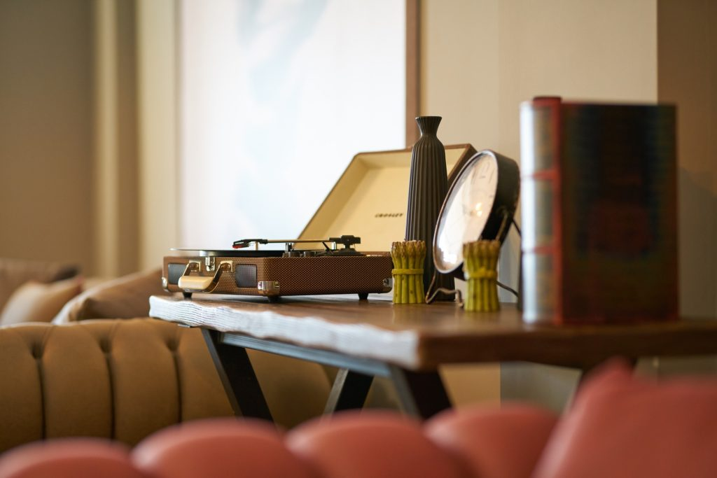 Brown, old timey, record player, leather bound book