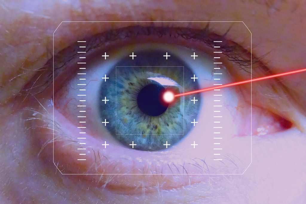 An zoomed in eye with a laser going in to it. A UI is covering most of the eye.