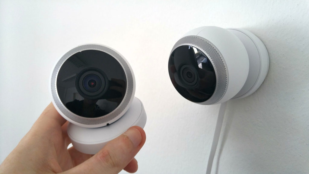 Security camera, wall mounted security camera, hand holding camera, hand
