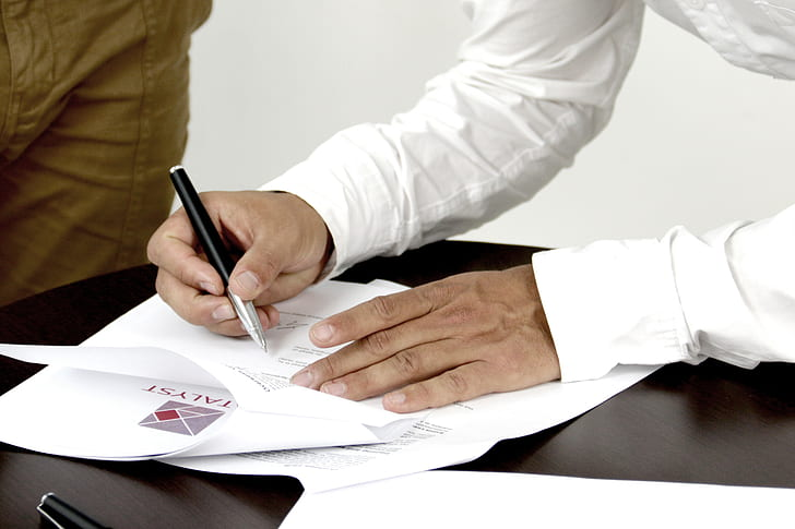 signature, contract, person signing a document, person, white, long, sleeved, top, holding, black, silver, retractable, pen