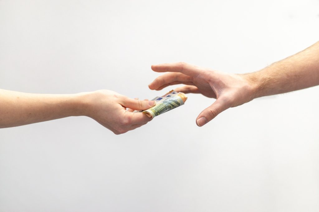 Hands, money, transaction