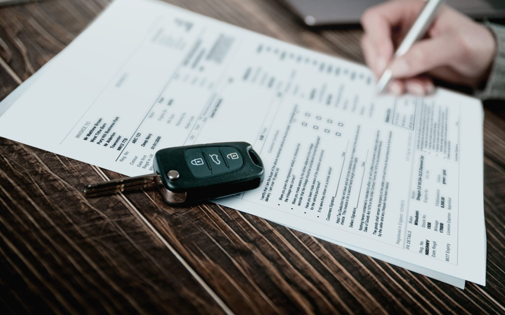 Car insurance, signing paper, car keys, contract